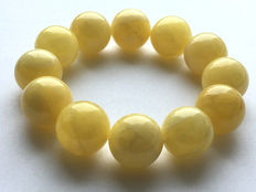 Baltic amber bracelet, white egg yolk color, 52.6 g