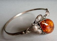 Solid silver bracelet set with an amber cabochon from the Baltic