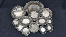 Collection of van 16 silver djokja bowls and coasters, Indonesia, 20th century