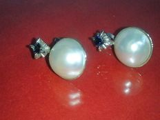 Earrings with genuine pearls and sapphires
