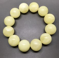 Bracelet of Baltic amber, milky colour, weight 44 grams