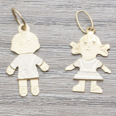Set of baby boy and baby girl pendants in 18 kt gold