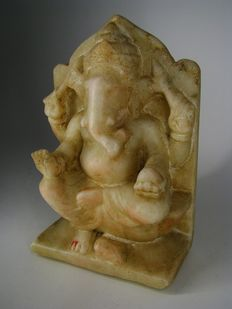 Heavy stone statue of Ganesha on throne - India - 19th century