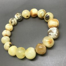 Bracelet of genuine Baltic amber, not treated, baroque round beads 11-13 mm in diameter