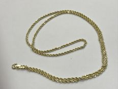 Rope style gold necklace.