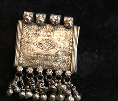 Large Indian talisman in a rectangular shape in chased silver with pendants.