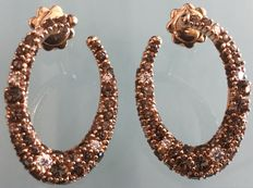 Earrings in 18 kt rose gold with transparent and champagne diamonds totalling 2 ct