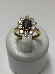 18 kt gold daisy ring with sapphire - no reserve price