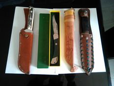 four knives for hunting , fishing, camping