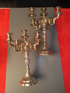 Pair of Rococo silver candlesticks, Italy, second half of the 20th century