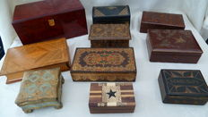 Ten wooden cases upholstered with leather, 1 red lacquered and a Spanish cigar box (see description)