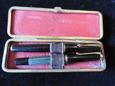 Very old fountain pens - one maker unknown, the other Pelican with 14ct gold nib - circa 1920 with pen case