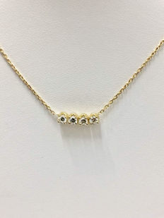 18 kt Gold necklace set in vertex with Top Wesselton diamonds of 0.40 ct.