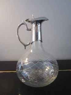 Crystal carafe with silver plated mounting