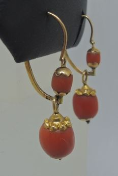 Gold earrings with red coral.