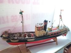 Large wooden ship with illumination and rotating propeller.