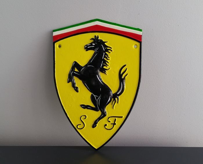 Ferrari emblem in iron.Fabric craft. 30cm х 20cm approximately.