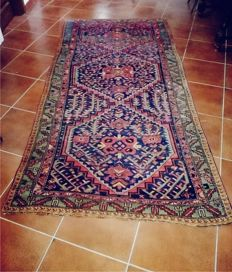 Antique authentic Western Caucasian rug, Kazak model, hand-knotted, with typical polygonal design matched with rich and imaginative patterns. Size: 266 x 128 cm