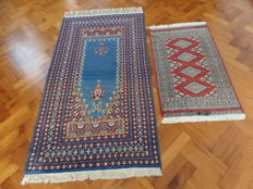 Two hand-knotted, Pakistani rugs, 168 x 93 cm and 102 x 61 cm.