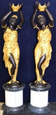 A pair of bronze and partially gilded and patinated lady figures on marble base, 170 cm high, 20th century