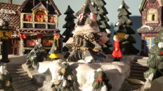 Christmas in a village scene with light and Santa Claus is comeing