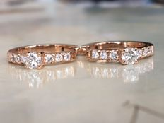 18 kt rose gold creole earrings, with in total approx. 0.60 ct brilliant cut diamonds, G-H/VS
