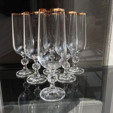 7 champagne flutes in very fine crystal decorated with gold thread