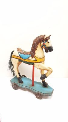 Wooden rocking horse on wheels - France, second half of the 20th century