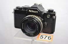 Beautiful Nikon FM black camera with Nikon lens series E 50 mm 1.8 lens