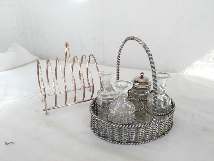 Antique silver plated four-piece condiment set with basket and toast rack - Origin: England, 1900s