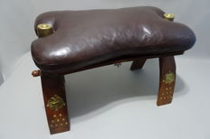 Camel saddle - bench / stool with leather seat.