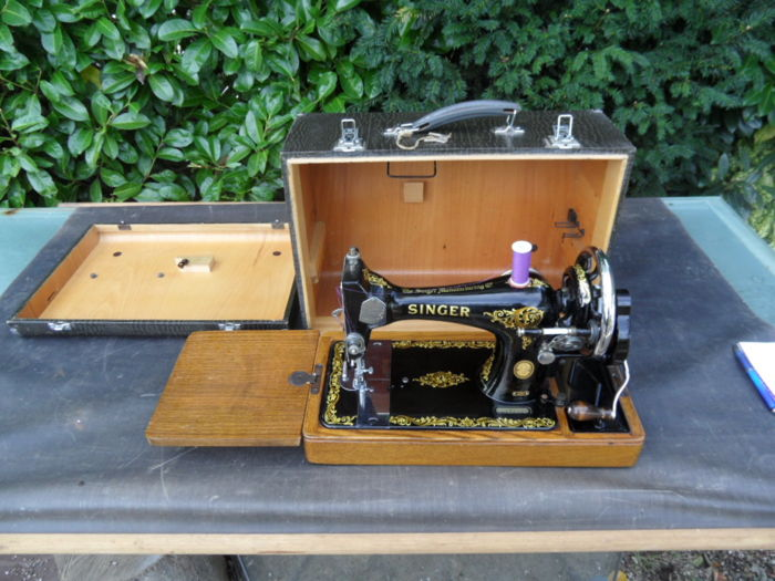 Singer 128K sewing machine with wooden case, coated with plastic, 1956