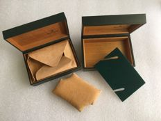 Rolex-- Two different versions of the classic wooden box--