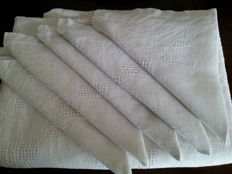 Fine hand embroidered tablecloth with 5 napkins.