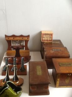 Pipe holders, tobacco boxes, matches; 10 pieces total.
