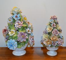 2 ceramic vases with ceramic flowers