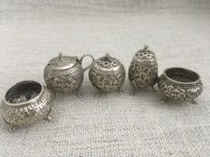 Kutch solid silver five - piece cruet set , Embossed design, India . Late 19th century