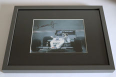 Nice framed image, personally signed by Keke Rosberg