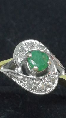 Two-tone gold ring with emerald and diamonds