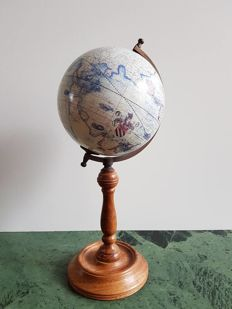 Small globe on high wooden base