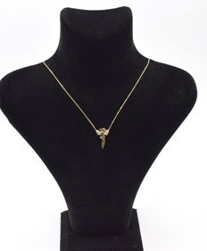14 carat yellow gold necklace  with Fairy pendant  43 cm