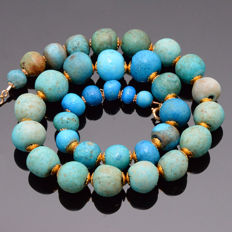 An Egyptian Faience Bead Necklace - L. 406 mm (16 inches)