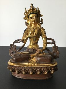 Depiction of Vajrasattva in copper with gold and brown patina, Nepal, early 21st century