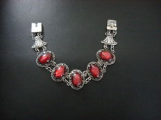 Antique bracelet with links set with red-purple stones