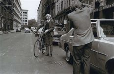 Robert Levin - Andy Warhol with a bicycle on East 11th Street in the Village, 1981