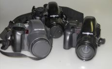 Olympus IS 100  Zoom 1:4.5-5.6 / 28-110 mm remote control and 2x Olympus IS 1000