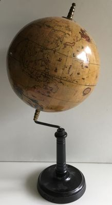 Old decorative globe with beautiful pictures on a wooden base