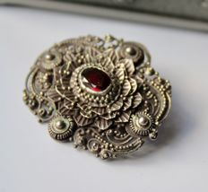 Victorian handcrafted silver brooch with antique Garnet built upon multiple levels, unique.