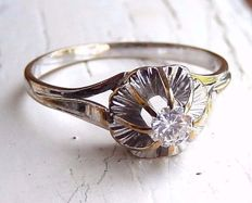 Antique solitaire engagement ring in 18 kt gold with diamond of 025 ct, circa  1920-1930.