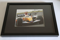 Nice framed image, personally signed by Giancarlo Fisichella